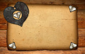 Old paper on wood texture with hearts — Stock Photo