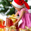 Cute xmas girl wihts gifts - Stock Photo