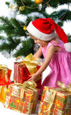 Cute xmas girl wihts gifts — Stock Photo