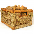 Basket of nuts on white background - Stock Photo