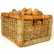 Basket of nuts on white background — Stock Photo