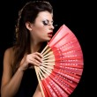 Beautiful woman with fan — Stock Photo