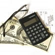 Calculator and dollars — Stock Photo