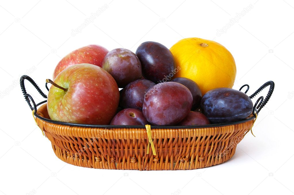 Basket of fruits isolated on a white background — Photo #1107217