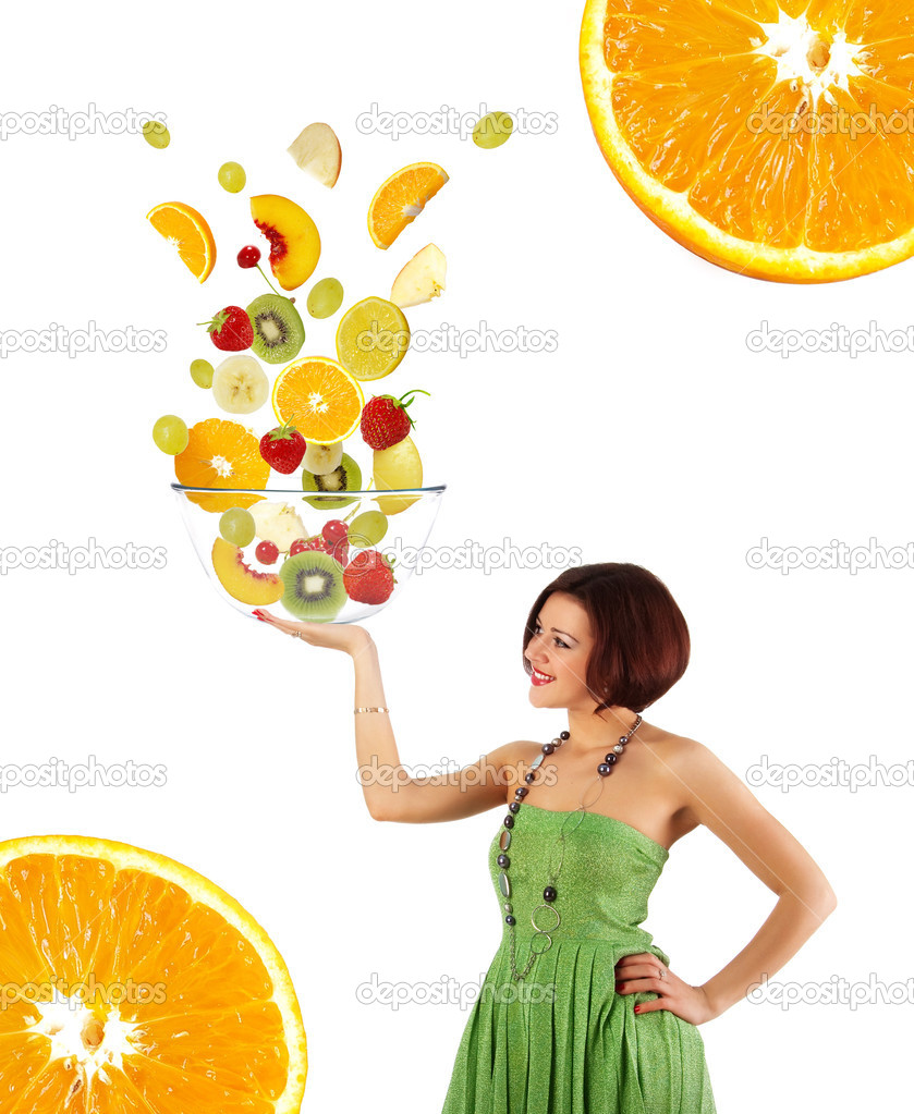 Beautiful young woman with a fruit salad on white background  Stock Photo #1108295