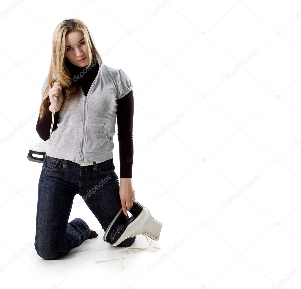 Beautiful young woman and skates on white — Stock fotografie #1108356