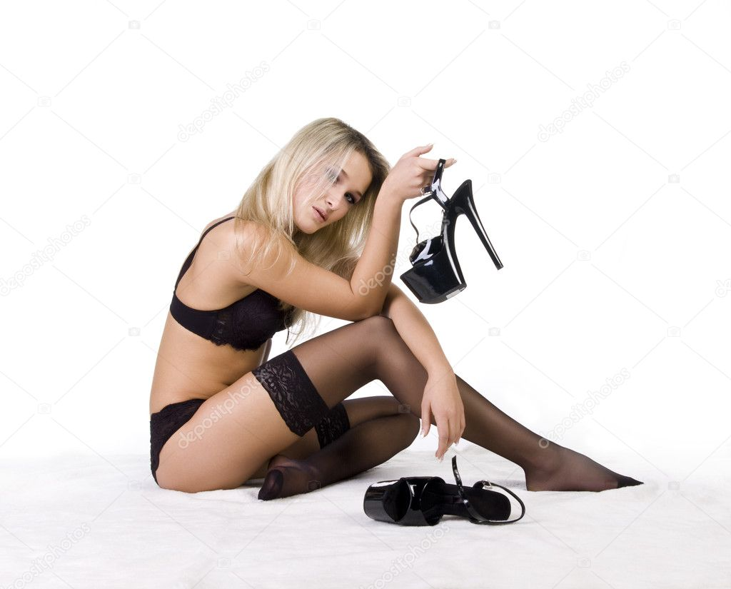 Blonde striptease performer in black underclothes on white background — Stock Photo #1108860