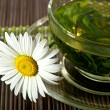 Cup of herbal tea and chamomile - Stock Photo