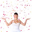Stock Photo: Cute bride throws rose petals