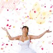 Cute bride throws rose petals and butter — Stock Photo