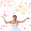 Stock Photo: Cute bride throws rose petals and butter