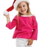 Cute girl in a santa claus hat — Stock Photo