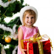 Cute girl with xmas gift — Stock Photo #1110374