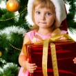 Cute girl with xmas gift - Stock Photo