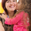 Cute little girl and her mother — Stock Photo