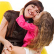 Cute little girl kiss her smiley mother — Stock Photo