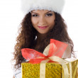 Cute woman with red christmas gift - Stockfoto