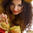 Cute woman with red christmas gift — Stock Photo
