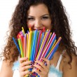 Cute young woman hold a lot of colorful - Stock Photo