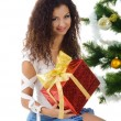 Royalty-Free Stock Photo: Cute young woman near christmas tree