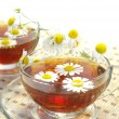 Stock Photo: Herbal tea and chamomile blossoms