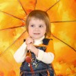 Little girl and open umbrella — Stock Photo #1111744