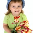 Little girl giving tulips — Stock Photo