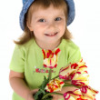 Little girl giving tulips — Stock Photo #1111773