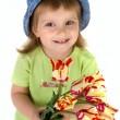 Little girl giving tulips — Stock Photo