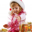 Little girl with a xmas gift - Stock Photo