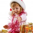 Little girl with a xmas gift — Stock Photo