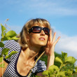 Stock Photo: Pretty woman in sunglasses