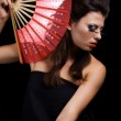 Pretty woman with fan — Stock Photo #1112221