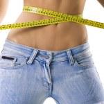 Woman measuring waist — Stock Photo