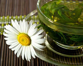 Cup of herbal tea and chamomile — Stock Photo