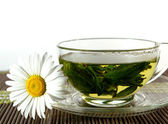 Cup of tea and chamomile — Stock Photo