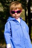 Cute little girl in sunglasses — Stock Photo