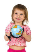 Little girl with terrestrial globe — Stock Photo