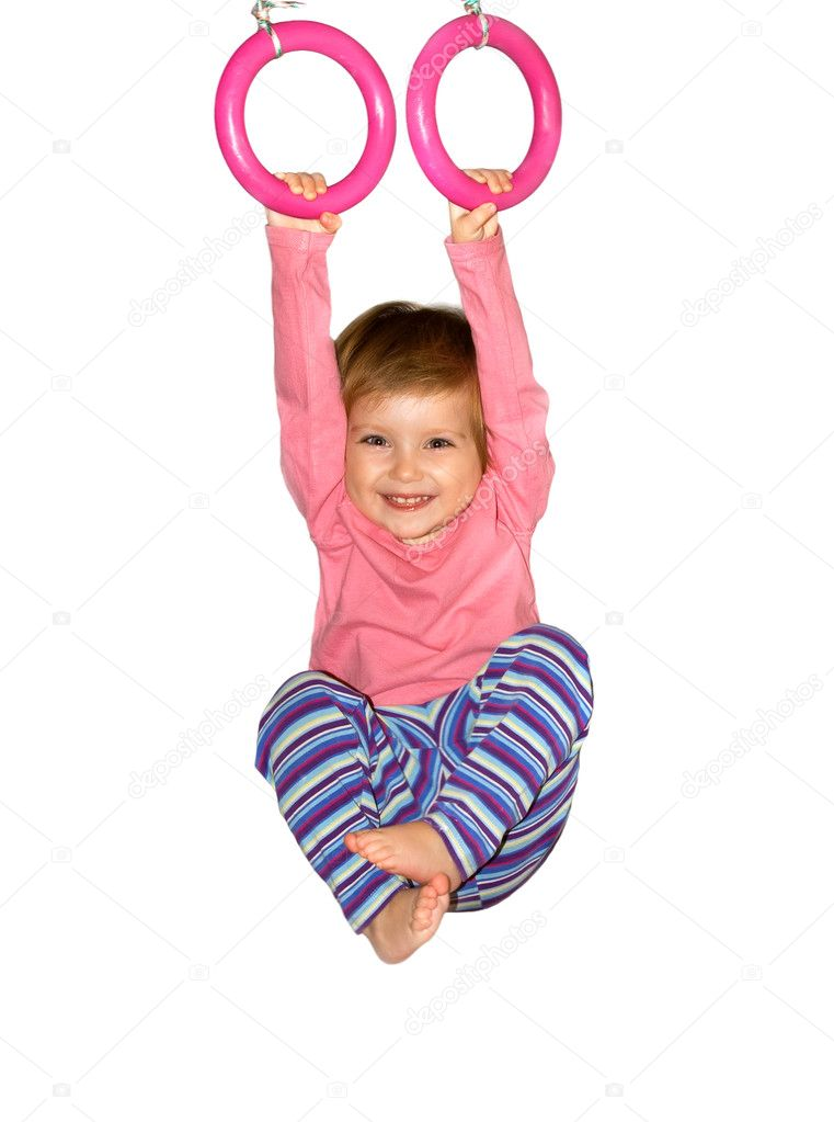 Cute girl hangs from rings on white background — Stock Photo #1110268