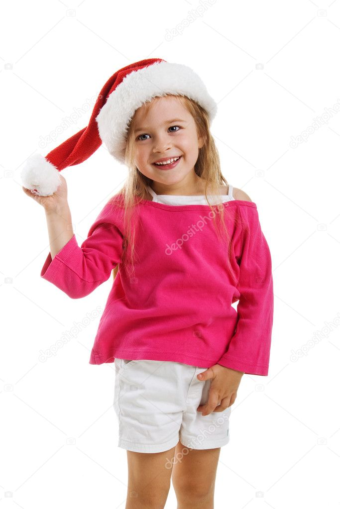 Cute little girl in a santa claus hat — Stock Photo #1110285