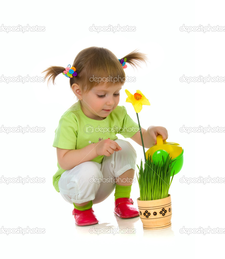 Cute little girl watering the flower. Studio shot  Stock Photo #1110305