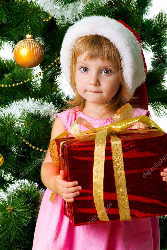 Cute girl with xmas gifts. Isolated on wite  Stock Photo #1110394