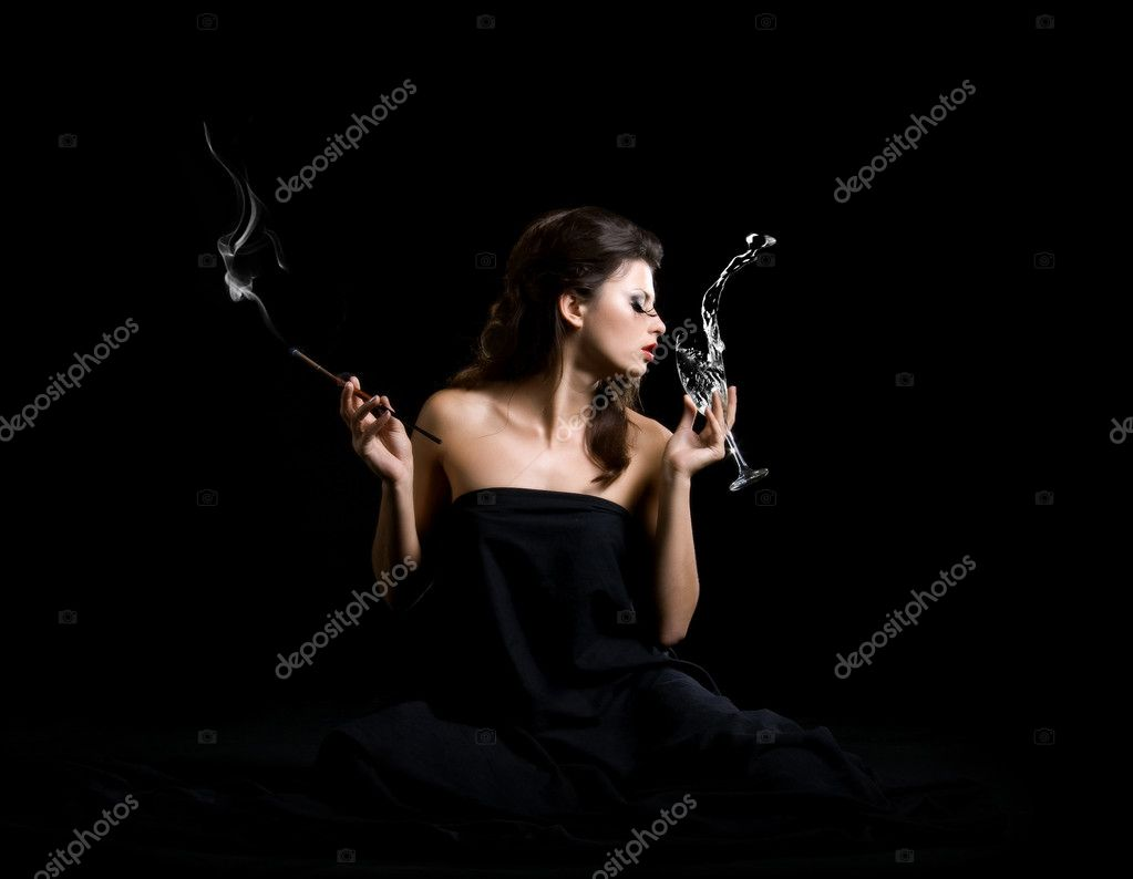 Glamour women with champagne and cigarette on black — Stock Photo #1111175
