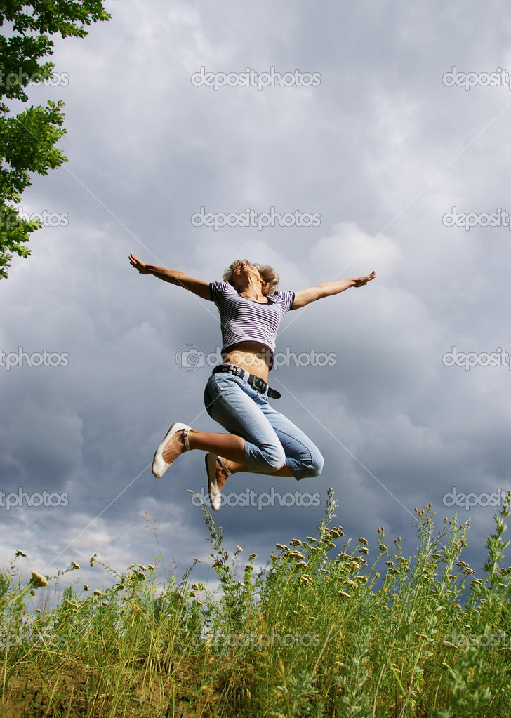 Happy young woman jumps. Sky as background  Stock Photo #1111434