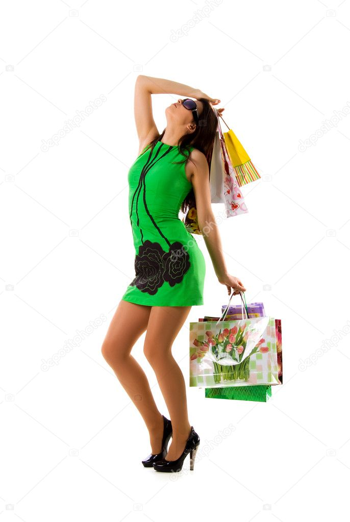 Pretty woman and bags on white background — Stock Photo #1112175