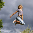 Beautiful young woman jumps — Stock Photo