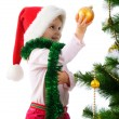 Cute girl near the christmas tree — Stockfoto