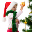Cute girl near the christmas tree - Foto Stock