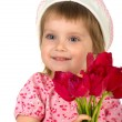 Cute little girl giving tulips — Stock Photo