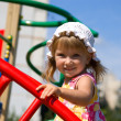 Cute little girl on playground — Stok Fotoğraf #1127446